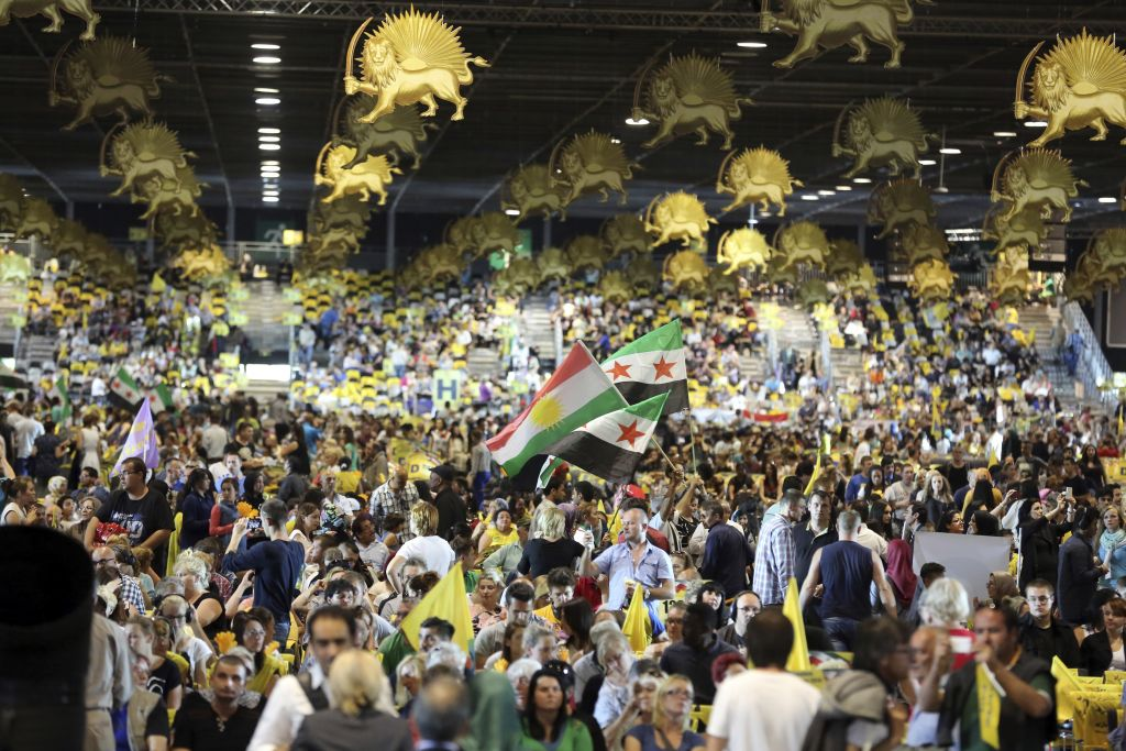 Thousands of exiled Iranians gathered in Villepinte, north of Paris, to listen to the speech of Maryam Rajavi, the leader of the National Council of Resistance of Iran, Friday June 27, 2014. (AP Photo/Rermy de la Mauviniere)