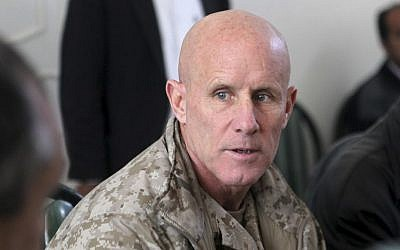 In this image provided by the US Marine Corps, Vice Adm. Robert S. Harward, commanding officer of Combined Joint Interagency Task Force 435, speaks to an Afghan official during his visit to Zaranj, Afghanistan, Jan. 6, 2011. (Sgt. Shawn Coolman/US Marine Corps via AP)