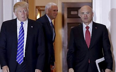 In this November 19, 2016 file photo, then President-elect Donald Trump walks Labor Secretary-designate Andrew Puzder from Trump National Golf Club Bedminster clubhouse in Bedminster, NJ. (AP Photo/Carolyn Kaster, File)