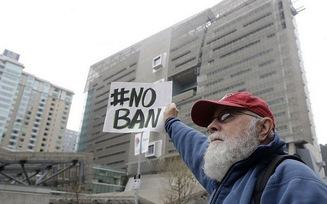 A protester holds a sign outside of the 9th US Circuit Court of Appeals in San Francisco, Tuesday, Feb. 7, 2017. (AP Photo/Jeff Chiu)