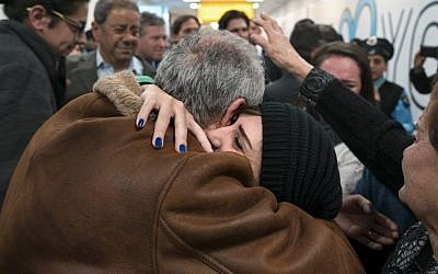 Family members who have just arrived from Syria embrace and are greeted by family who live in the United States upon their arrival at John F. Kennedy International Airport in New York, Monday, Feb. 6, 2017. (AP Photo/Craig Ruttle)