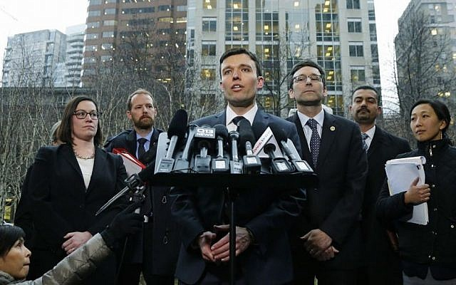 Washington state Solicitor General Noah Purcell, center, talks to reporters as Attorney General Bob Ferguson, third from right, looks on, Friday, Feb. 3, 2017 (AP Photo/Ted S. Warren)