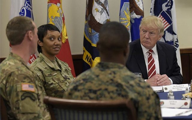 President Donald Trump has lunch with troops while visiting US Central Command and US Special Operations Command at MacDill Air Force Base, Fla., Monday, Feb. 6, 2017. (AP Photo/Susan Walsh)