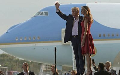 "President Donald Trump and first lady Melania Trump arrive for the ""Make America Great Again Rally"" at Orlando-Melbourne International Airport in Melbourne, Florida, Saturday, Feb. 18, 2017. (AP Photo/Susan Walsh)"