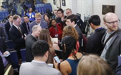 Reporters line up in hopes of attending a briefing in Press Secretary Sean Spicer's office at the White House in Washington, Friday, Feb. 24, 2017. The White House held an off camera briefing in Spicer's office, where they selected who could attend. (AP Photo/Pablo Martinez Monsivais)