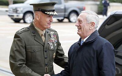 Joint Chiefs Chairman Gen. Joseph Dunford greets Defense Secretary Jimn Mattis at the Pentagon, January 21, 2107. (AP Photo/Alex Brandon, File)