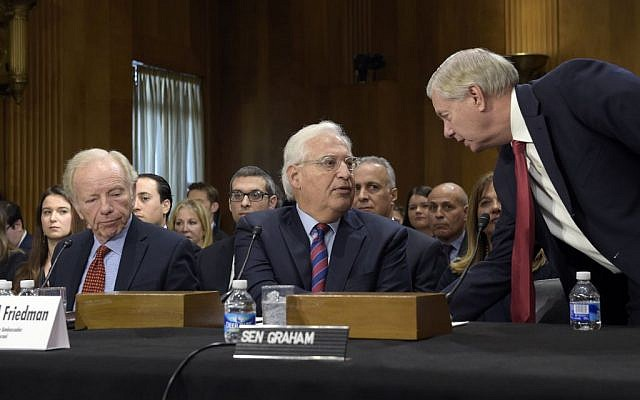 In this Wednesday, Feb. 15, 2017 photo, Sen. Lindsey Graham, R-SC, right, talks with David Friedman, center, nominated to be US ambassador to Israel, accompanied by former Connecticut Sen. Joseph Lieberman on Capitol Hill in Washington, during Friedman's confirmation hearing before the Senate Foreign Relations Committee. (AP Photo/Susan Walsh)