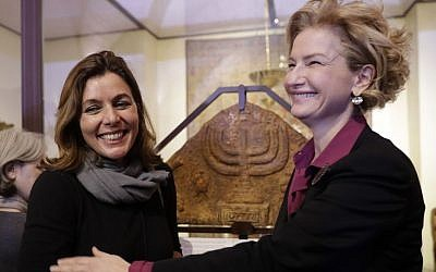 Director of the Vatican Museums, Barbara Jatta, left, and Director of Rome's Jewish Museum Alessandra Di Castro pose for a photo in front of a bas-relief showing a menorah at the end of a press conference in Rome, Monday, February 20, 2017. (AP/Alessandra Tarantino)