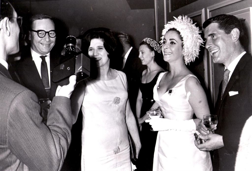 Victor and Lilian Hochhauser, Russian dancer Raisa Struchkova and Elizabeth Taylor at a party for the Bolshoi Ballet 1963. (Courtesy)