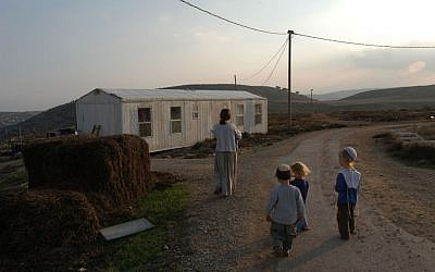 A family walking in the Adei Ad outpost on November 27, 2003. (Flash90 )
