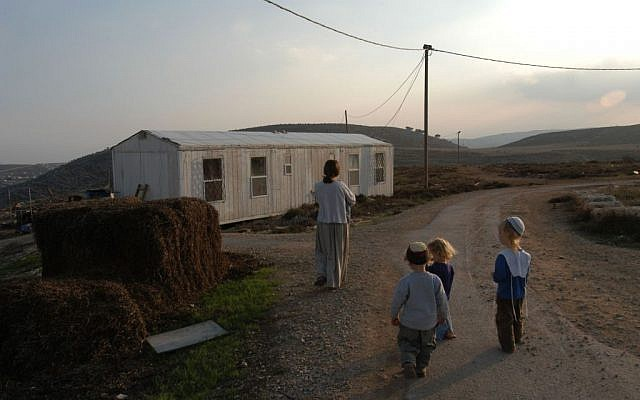 A family walking in the Adei Ad settlement on November 27, 2003. (Flash90 )