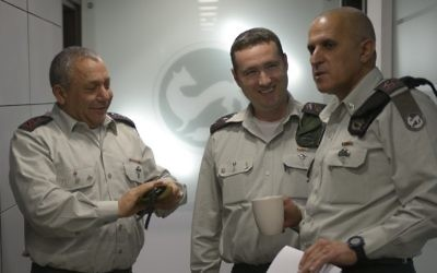 From left, IDF Chief of Staff Lt. Gen. Gadi Eisenkot speaks to incoming IDF spokesperson Col. Ronen Manelis and former head of the Southern Command Maj. Gen. (res.) Sami Turgeman in an undated photograph. (IDF Spokesperson's Unit)
