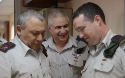 From left, IDF Chief of Staff Lt. Gen. Gadi Eisenkot, outgoing IDF Spokesperson Maj. Gen. Moti Almoz and incoming spokesperson Col. Ronen Manelis in an undated photograph. (IDF Spokesperson's Unit)