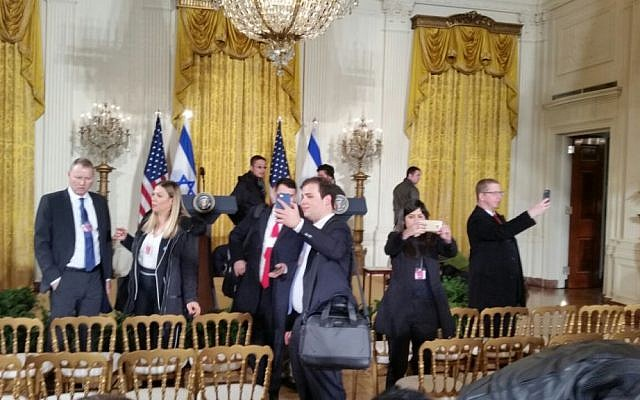 Israeli reporters taking selfies in the East Room of the White House on February 15, 2017. (Raphael Ahren/Times of Israel)