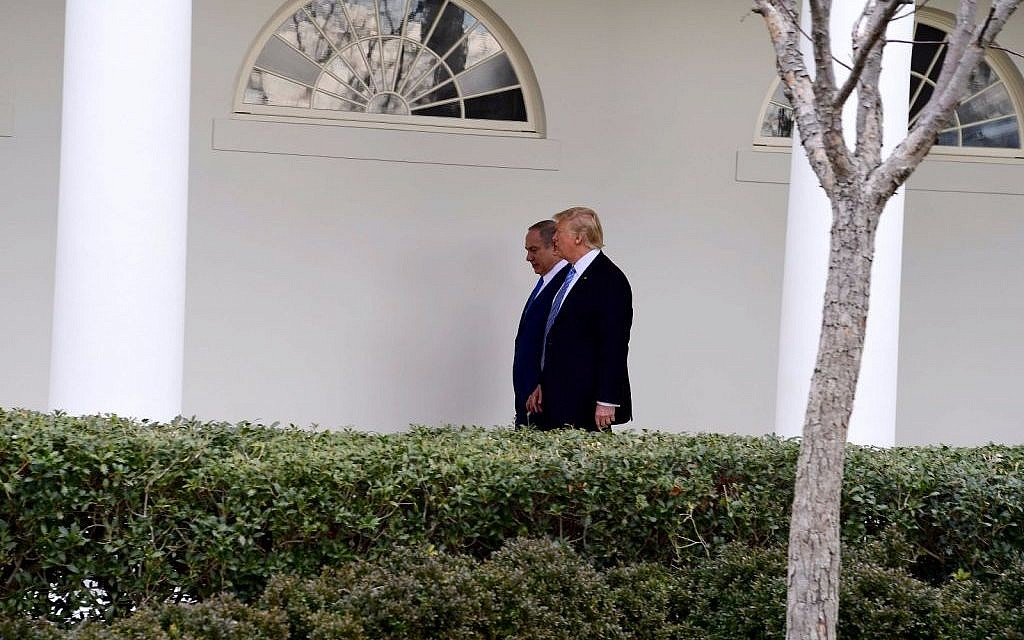 Donald Trump, right, and Benjamin Netanyahu, walking in the White House grounds on February 15, 2017. (Avi Ohayun/GPO)