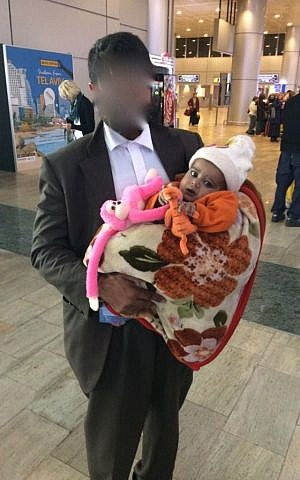 Two-year-old Yacub and his father arrive in Ben Gurion airport on February 14th, 2017. (Courtesy)