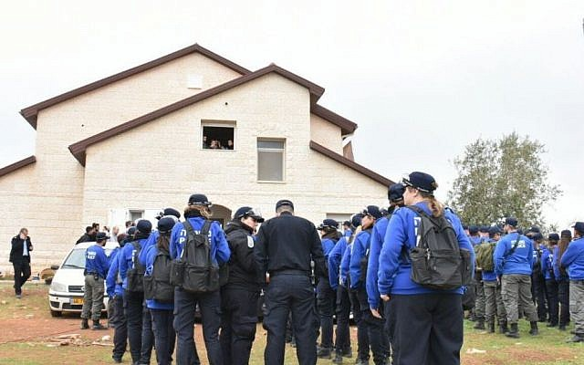 Police officers being clearing out protesters and residents of nine buildings found to have been built illegally in the Ofra settlement on February 28, 2017. (Israel Police)