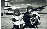 Illustrative: Children being airlifted from Yemen in Operation Magic Carpet, in front of an Alaskan Airlines plane. (Courtesy AJM)