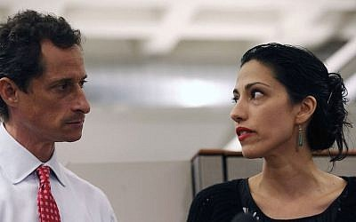Anthony Weiner and Huma Abedin at a news conference in New York City at which Weiner acknowledged that he engaged in lewd online conversations with a woman after his resignation from Congress, July 23, 2013. (John Moore/Getty Images)