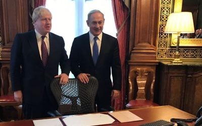 An image posted by Benjamin Netanyahu on Facebook shows him standing with British Foreign Secretary Boris Johnson in the room in London's Foreign Office where Arthur Balfour signed his famous 1917 declaration. February 6, 2017 (Facebook)