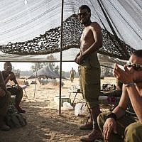 Illustrative: Bedouin IDF soldiers in a tent they set up in a field near the Gaza border in southern Israel, on July 6, 2014. (Hadas Parush/Flash90)