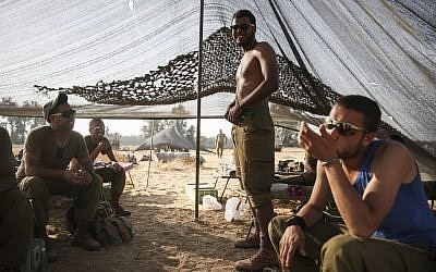 Illustrative: Bedouin IDF soldiers seen in a tent they set up in a field near the Gaza border in southern Israel, on July 6, 2014. (Hadas Parush/Flash90)