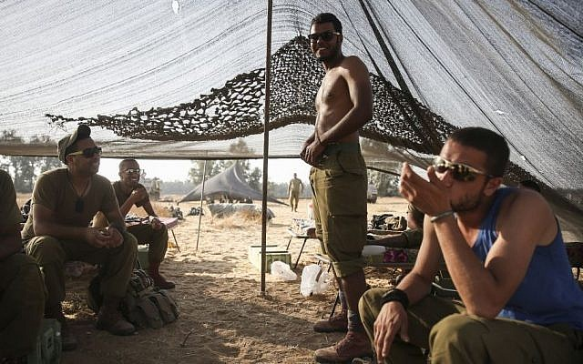 Bedouin IDF soldiers seen in a tent they set up in a field, near the Gaza border in southern Israel, on July 6, 2014. Photo by Hadas Parush/Flash90