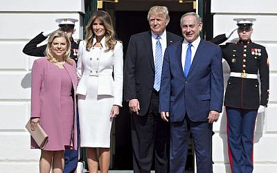 President Donald Trump, second from right, and wife Melania, with Israeli Prime Minister Benjamin Netanyahu and wife Sara, left, at the South Portico of the White House, Feb. 15, 2017. (Andrew Harrer-Pool/Getty Images)