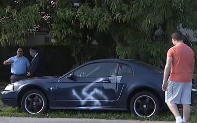 A large swastika is spray-painted on the side of a car in a predominantly Jewish neighborhood in Boca Raton, Florida, on February 12, 2017. (screen capture: 7News Miami)