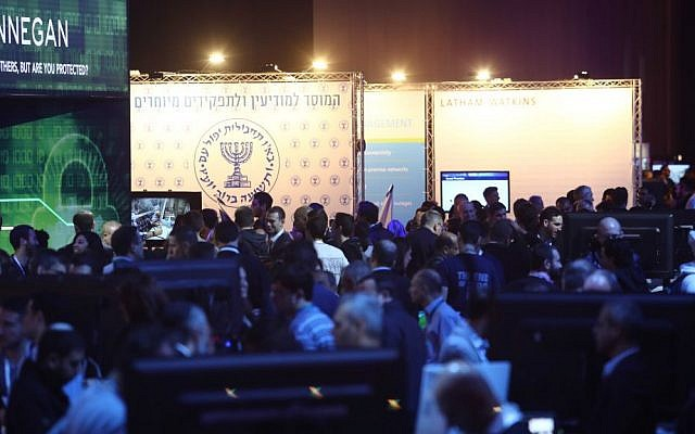 The Mossad symbol appears in the background of this picture of participants at CyberTech 2017 (Courtesy: Gilad Kavalerchik)