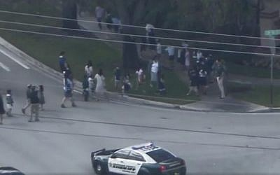 Children evacuating from a Jewish school in Davie Florida, on February 27, 2017. (screen capture: WPLGLocal10/Facebook)