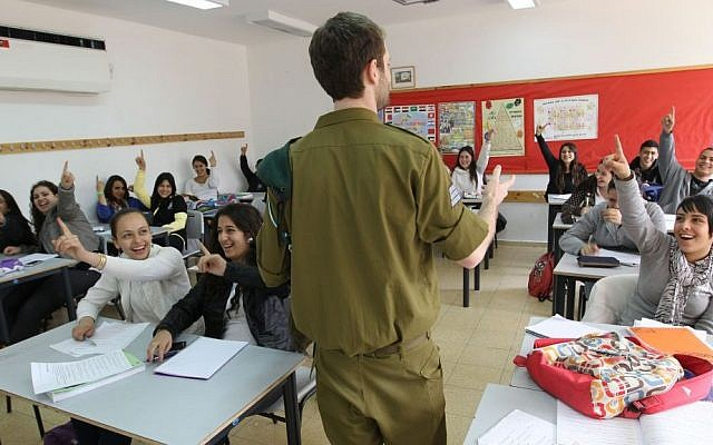 A class full of students raise their hands to answer a question on April 4, 2011 at the Branco Weiss School in Beit Shemesh that offers classes that specialize in intelligence studies in cooperation with the IDF Military intelligence unit. (Nati Shohat/Flash90)