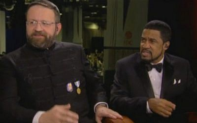 Sebastian Gorka, left, a top aide to US President Donald Trump, seen on inauguration day wearing the uniform and medal of Vitézi Rend, a Hungarian order of merit with ties to Nazi Germany (Fox News)