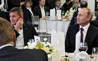 Former US National Security Advisor Michael Flynn (L) alongside Russian President Vladimir Putin at a dinner event celebrating Russian TV network RT's 10th anniversary in Moscow, Russia. (Screen capture/YouTube)