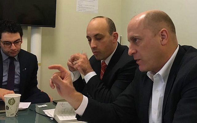 Gidi Grinstein, right, and ADL CEO Jonathan Greenblatt, center, in the Jewish Telegraphic Agency office in New York, Feb. 2, 2017. (Courtesy of Reut)