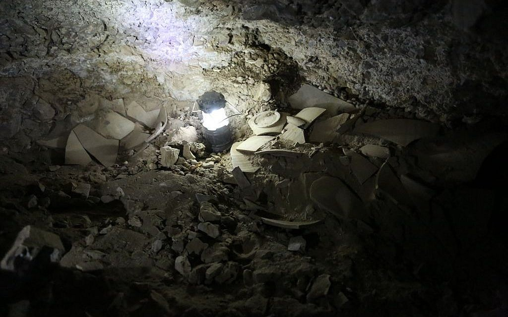Fragments of shattered jars believed to have contained stolen Dead Sea scrolls, found in cave 12 near Qumran. (Casey L. Olson and Oren Gutfeld, Hebrew University)