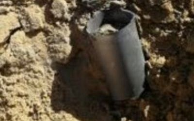 One of two rockets fired at southern Israel from the Sinai Peninsula on February 20, 2017. It struck in an open field near the Naveh community. (Israel Police)