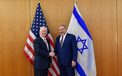 Defense Minister Avigdor Liberman shakes hands with US Secretary of Defense James Mattis at the Munich Security Conference on February 17, 2017. (Ariel Hermoni/Defense Ministry)