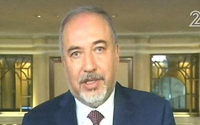 Defense Minister Avigdor Liberman talks to Israeli TV from a security conference in Munich, Germany on February 17, 2017 (screen capture: Channel 2)