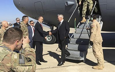 US Secretary of Defense James Mattis, center, is greeted by U.S. Ambassador Douglas Silliman as he arrives at Baghdad International Airport on an unannounced trip Monday, Feb. 20, 2017. (Lolita Baldor/AP)