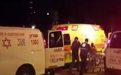 Rescue workers treat the victim of a shooting in Netanya on February 27, 2017 Screen capture/ YouTube)