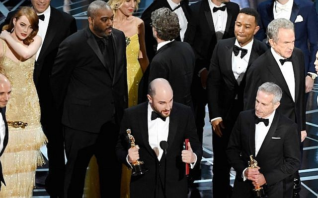 (L-R) Prior to learning of a presentation error, 'La La Land' producers Fred Berger, Jordan Horowitz and Marc Platt accept the Best Picture award for 'La La Land' (later awarded to actual Best Picture winner 'Moonlight') onstage during the 89th Annual Academy Awards at Hollywood and Highland Center on February 26, 2017 in Hollywood, California.  (Photo by Kevin Winter/Getty Images via JTA)