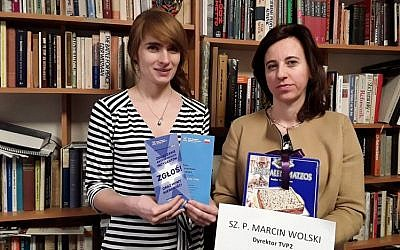 Anna Chipczynska, president of the Jewish Community of Warsaw, right, and Ania Bakula holding the contents of a package they sent to a TV director on Jan. 22, 2017. (Photo Courtesy of the Jewish Community of Warsaw)