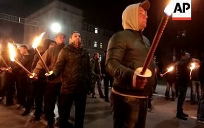 Demonstrators hold torches at the Lukov March in Sofia, Bulgaria on February 14, 2016. (Screen capture/YouTube)