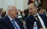 President Reuven Rivlin, left, and Education Minister Naftali Bennett, right, at a conference for regional education department heads in Jerusalem on February 28, 2017. (Mark Neyman/GPO)