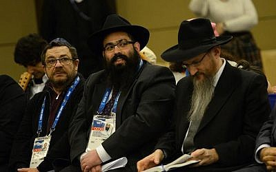 Rabbis Ari Edelkopf, center, and Berel Lazar, right, listen to a speech at a reception of the Federation of Jewish Communities of Russia in Sochi, Russia, February 9, 2017. (Courtesy of Federation of Jewish Communities)