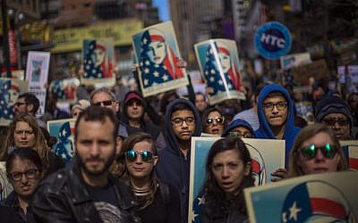 Illustrative: People carry posters during a rally in support of Muslim Americans and protest of US President Donald Trump's immigration policies in Times Square, New York, Sunday, Feb. 19, 2017. (Andres Kudacki/AP)