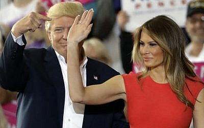 US President Donald Trump points to his wife, first lady Melania Trump during a campaign rally Saturday, Feb. 18, 2017, at Orlando-Melbourne International Airport, in Melbourne, Fla. (Chris O'Meara/AP)
