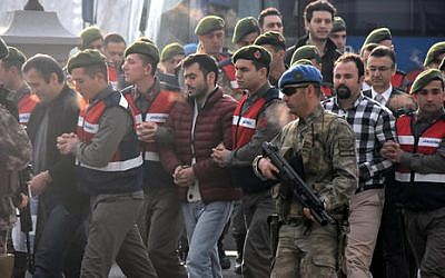 Paramilitary police escort the defendants as a trial opened in Mugla, Turkey, Monday, Feb. 20, 2017, for 47 people accused of attempting to kill President Recep Tayyip Erdogan in a failed coup (DHA-Depo Photos/AP)
