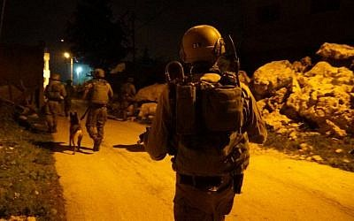 Illustrative: IDF soldiers during an arrest raid in the central West Bank on February 23, 2017. (IDF Spokesperson's Unit)